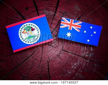 Belize Flag With Australian Flag On A Tree Stump Isolated