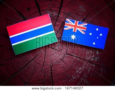 Gambian Flag With Australian Flag On A Tree Stump Isolated