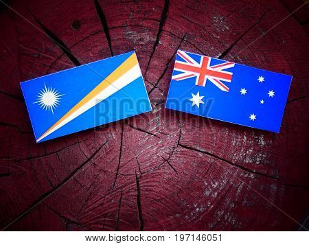 Marshall Islands Flag With Australian Flag On A Tree Stump Isolated