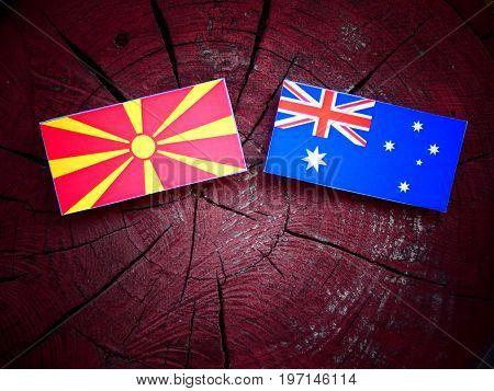 Macedonian Flag With Australian Flag On A Tree Stump Isolated