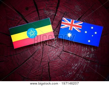 Ethiopian Flag With Australian Flag On A Tree Stump Isolated