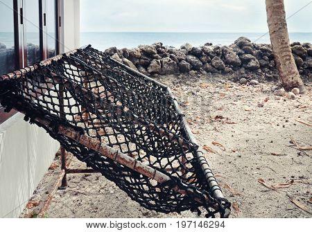 Seats near bungalow on beach at sea resort