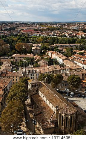 Image of the Saint Gimer's Church located in the base town of the fortified city of Carcassonne located in the Aude department of France.Here is a view from the walled city.This church was created by the architect Eugene Viollet-le-Duc.In sec.XIX he renov