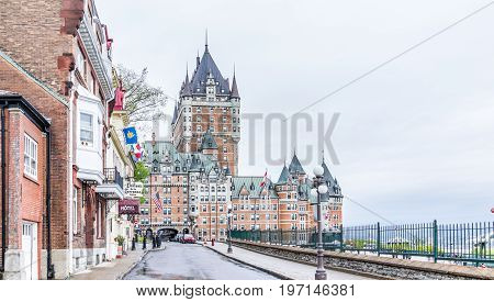 Quebec City, Canada - May 30, 2017: Old Town Street Called Rue Des Carrieres And View Of Hotel Chate