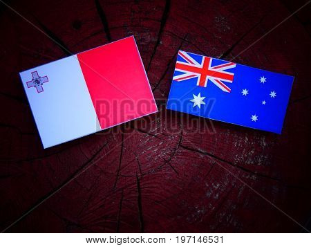 Maltese Flag With Australian Flag On A Tree Stump Isolated