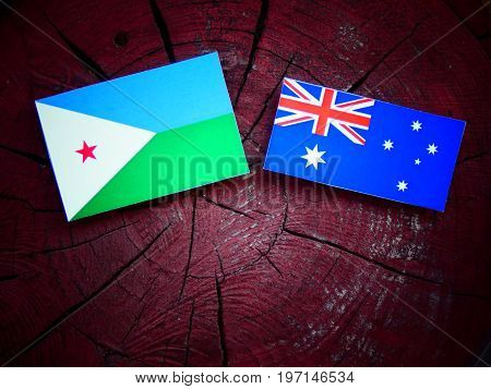 Djibouti Flag With Australian Flag On A Tree Stump Isolated