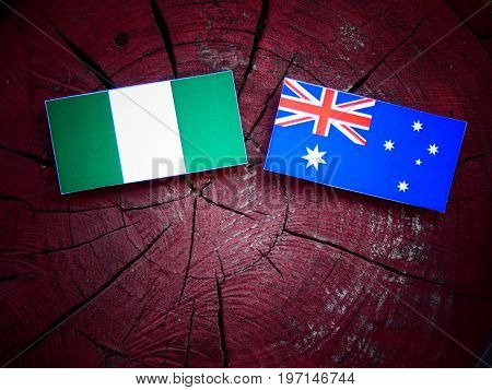 Nigerian Flag With Australian Flag On A Tree Stump Isolated
