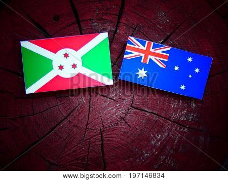 Burundi Flag With Australian Flag On A Tree Stump Isolated
