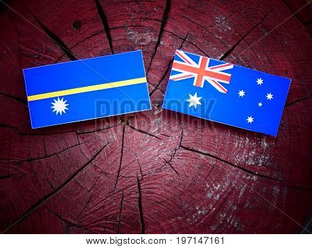 Nauru Flag With Australian Flag On A Tree Stump Isolated