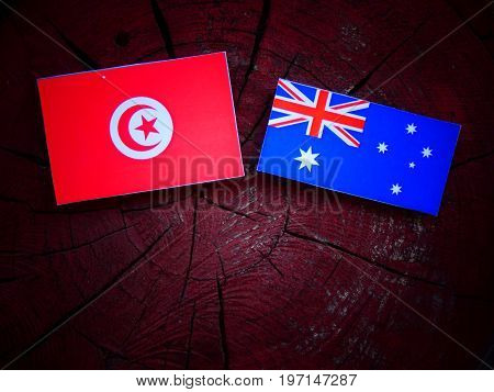 Tunisian Flag With Australian Flag On A Tree Stump Isolated