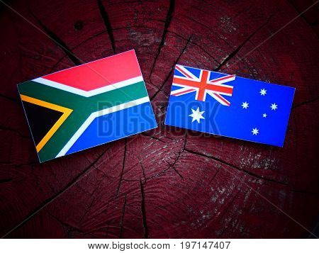 South African Flag With Australian Flag On A Tree Stump Isolated