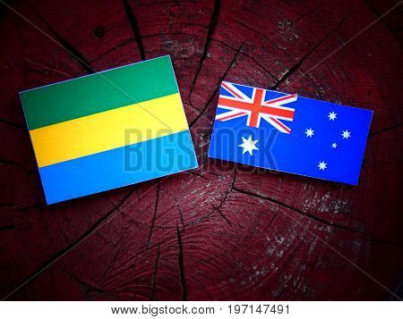 Gabon Flag With Australian Flag On A Tree Stump Isolated