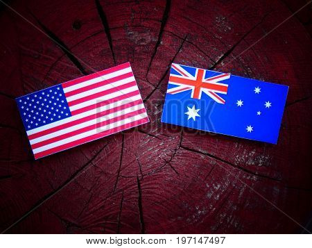Usa Flag With Australian Flag On A Tree Stump Isolated