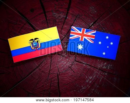 Ecuador Flag With Australian Flag On A Tree Stump Isolated