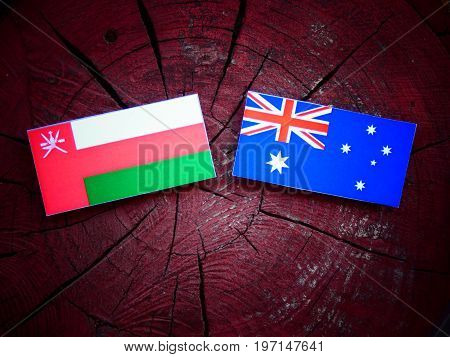 Omani Flag With Australian Flag On A Tree Stump Isolated