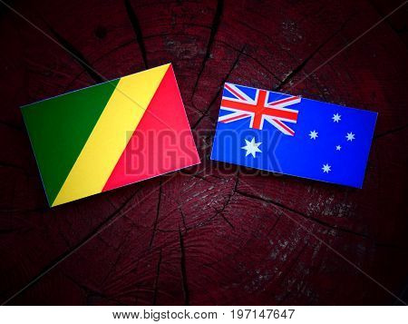 Republic Of The Congo Flag With Australian Flag On A Tree Stump Isolated