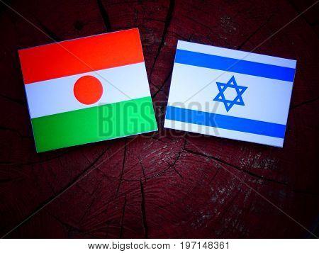 Niger Flag With Israeli Flag On A Tree Stump Isolated