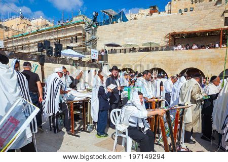 JERUSALEM, ISRAEL - OCTOBER 12, 2014:  The area in front of Western Wall of Temple filled with people.  The Jews  in Morning autumn Sukkot, Blessing of the Kohanim