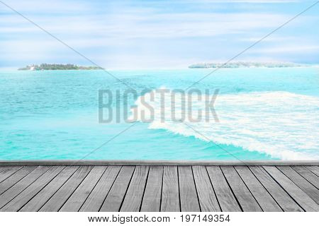 View of wooden pontoon and blue sea at resort on summer day