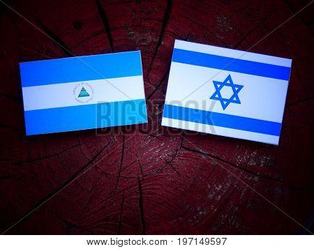Nicaraguan Flag With Israeli Flag On A Tree Stump Isolated