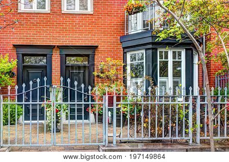 Quebec City, Canada - May 30, 2017: Closeup Of Old Town Residential Building With Gate And Door Entr