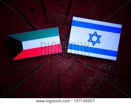 Kuwaiti Flag With Israeli Flag On A Tree Stump Isolated