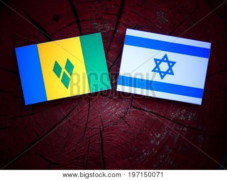 Saint Vincent And The Grenadines Flag With Israeli Flag On A Tree Stump Isolated