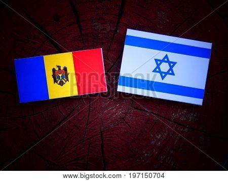 Moldovan Flag With Israeli Flag On A Tree Stump Isolated