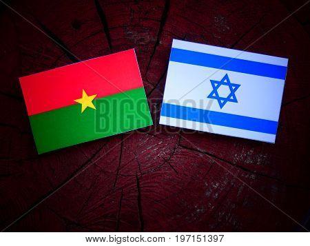 Burkina Faso Flag With Israeli Flag On A Tree Stump Isolated