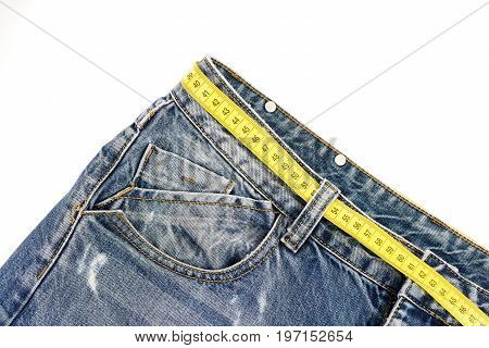 Dieting Concept: Jeans With Yellow Measure Tape Instead Of Belt