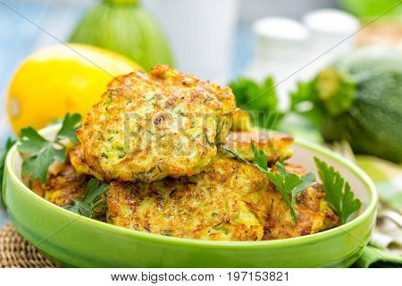 Zucchini pancakes on plate on table closeup