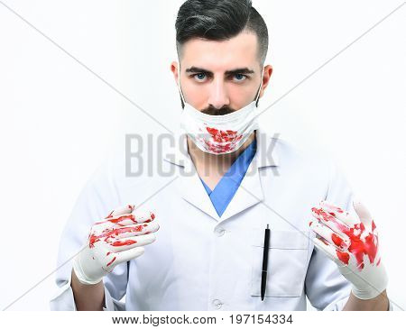 Doctor In Latex Gloves And Surgical Mask With Confident Sight
