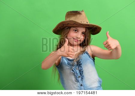 Little Lady In Stylish Clothes On Green Background