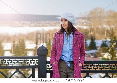 The Girl Is Standing By The Railing