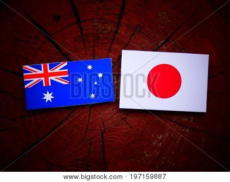 Australian  Flag With Japanese Flag On A Tree Stump Isolated