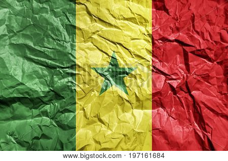Senegal flag painted on crumpled paper background