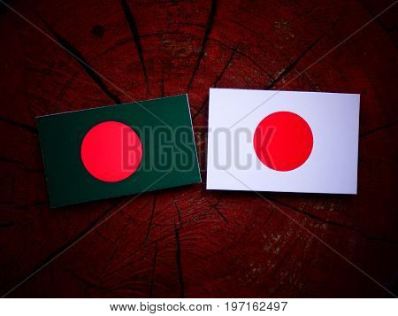 Bangladesh Flag With Japanese Flag On A Tree Stump Isolated