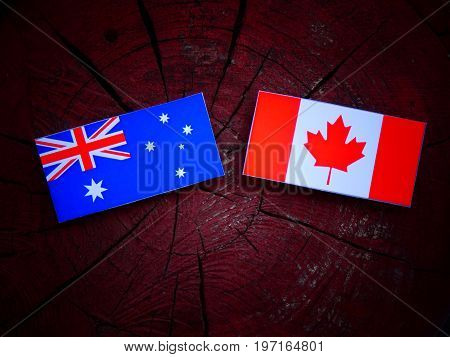 Australian Flag With Canadian Flag On A Tree Stump Isolated