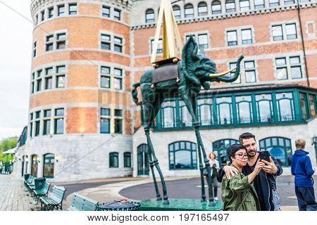 Quebec City, Canada - May 30, 2017: Chateau Frontenac And Elephant Salvador Dali Statue Sculpture Ar
