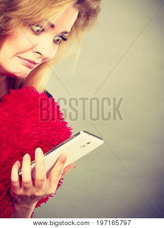 Shocked Heartbroken Woman Looking At Her Phone
