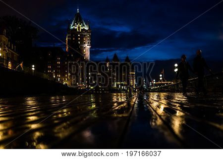 Quebec City Canada - May 30 2017: Old town closeup view of wet dufferin terrace at night with Chateau Frontenac
