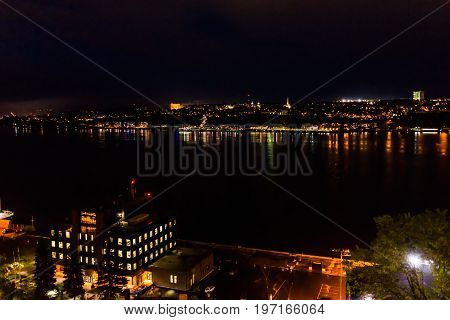 Cityscape or skyline aerial view of Saint Lawrence river and Levis at night in Quebec City Canada