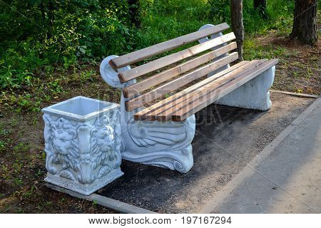 Park bench with trashcan part of city infrastructure comfortable relax