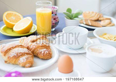Continental breakfast coffee milk orange juice and croissant