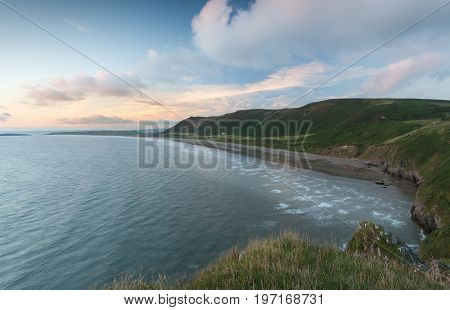 Editorial Swansea, UK - July 23, 2017: Rhossili Bay at the far tip of the Gower peninsula, showing The Old Rectory, possibly the most photographed house in Wales, UK