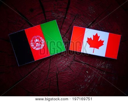 Afghani Flag With Canadian Flag On A Tree Stump Isolated