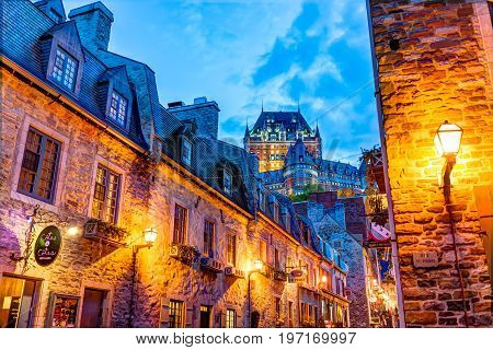 Quebec City, Canada - May 31, 2017: Colorful Lower Old Town Cobblestone Street With Stone Wall Build