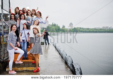 Fabulous Bridesmaids Posing At The Quay Next To The Lake With Their Flawless Bride. Bachelorette Par