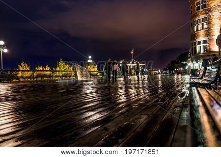 Quebec City, Canada - May 31, 2017: Old Town View Of People Walking On Dufferin Terrace At Night Wit