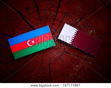 Azerbaijan  Flag With Qatari Flag On A Tree Stump Isolated
